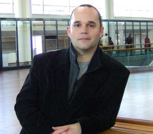 A photograph of author Ryan Asmussen