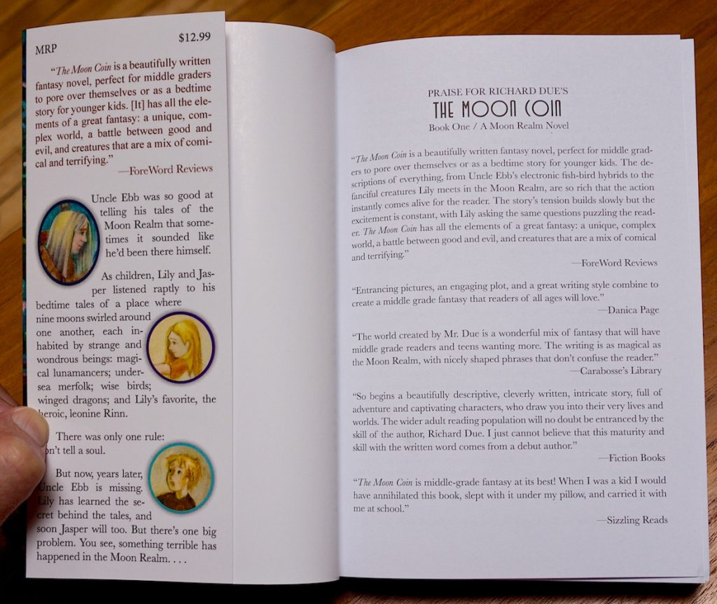 A photograph of The Moon Coin book showing Fiction Books name in print