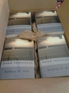 An Image of a box of 'Good Intentions', the debut novel of author Kathryn Biel, fresh off the press