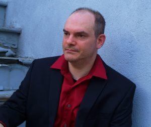 photograph of author Adam Pepper