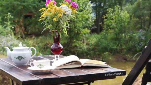 Tea and book on a table in the garden